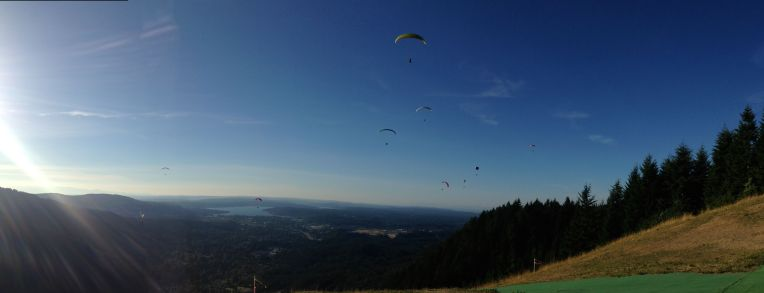 Paragliders and a hang glider at Tiger Mountain's Poo Poo Point.