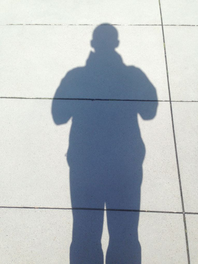 Me. Wishing I was running and not taking a photo of my standing shadow.