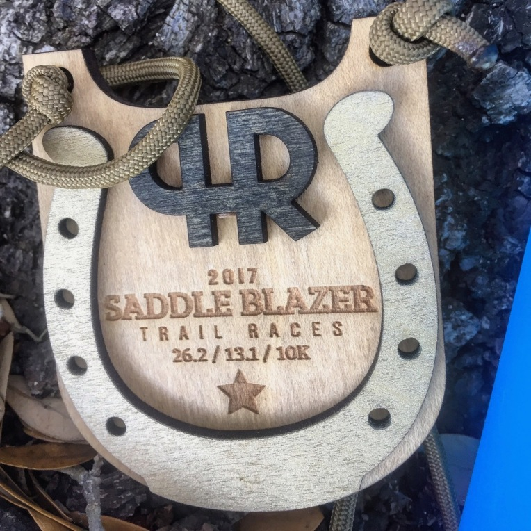 Saddle Blazer Trail Marathon finisher medal.